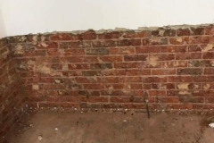 Evidence of rising damp and new DPC injection